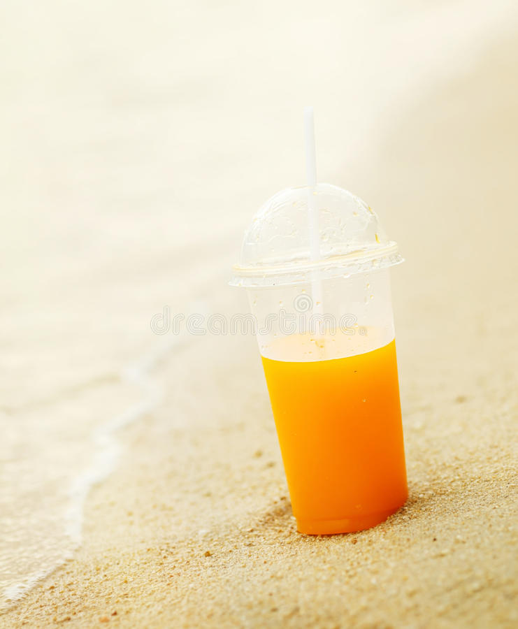 Orange Juice on the beach.  stock photography