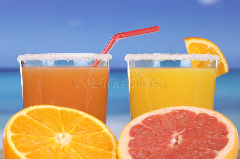 Orange juice on the beach. Orange juice or cocktail on the beach while on vacation stock photo