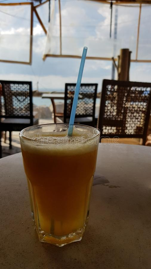 Orange juice at beach coffee. Orange juice beach coffee holidays stock photo