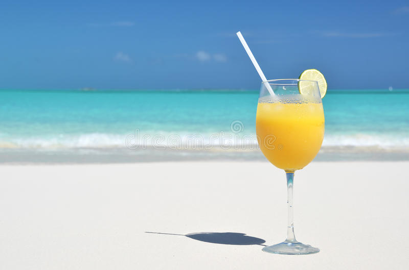 Orange juice on the beach stock photo
