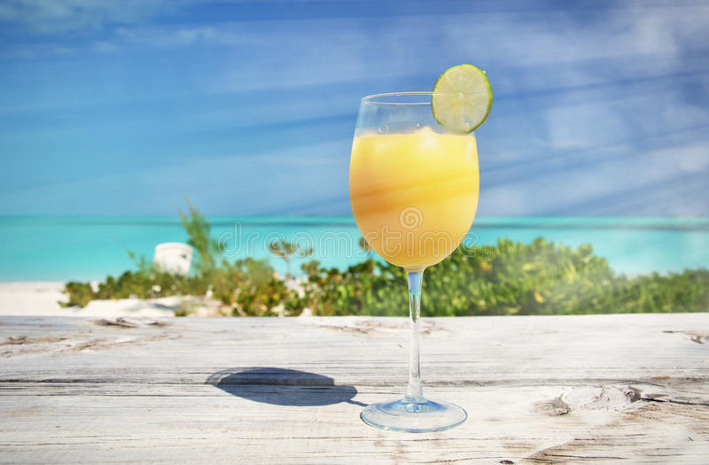Orange juice on the beach. Exuma, Bahamas stock image