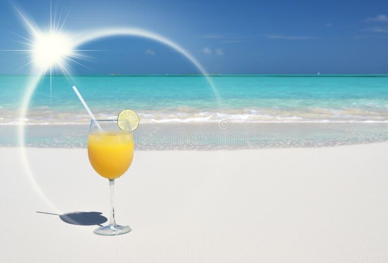 Orange juice on the beach. Great Exuma, Bahamas stock photo