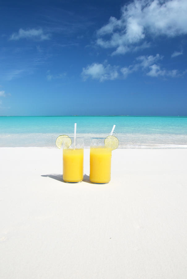 Orange juice on the beach. Great Exuma, Bahamas stock photos