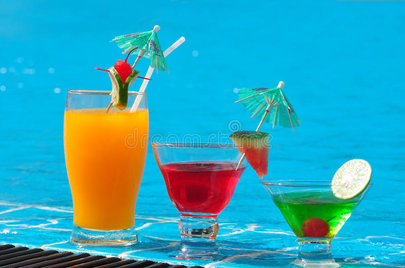 Orange juice and Cocktails near the swimming pool stock images