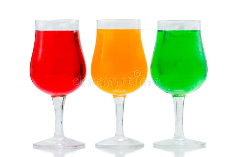 Orange juice. Colorful drinking in a glass on white background stock image