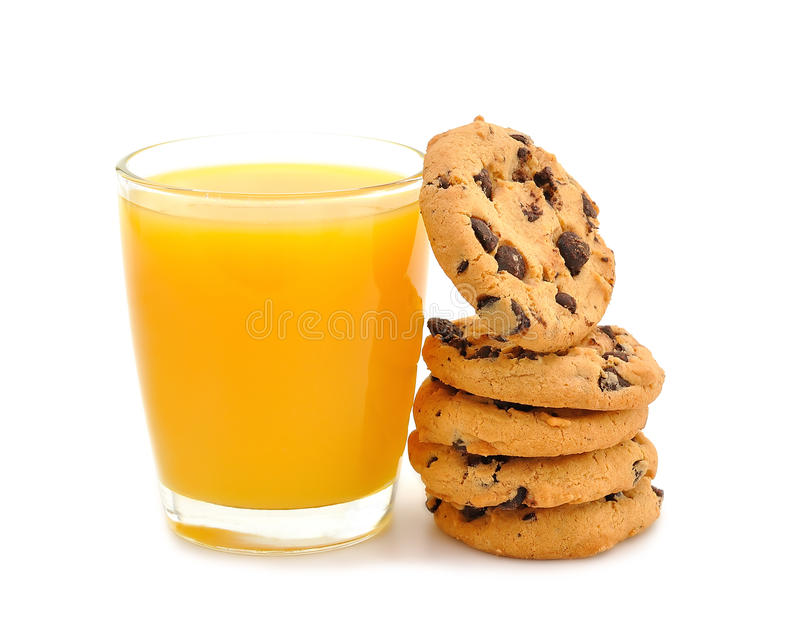 Orange juice and cookies stock photography