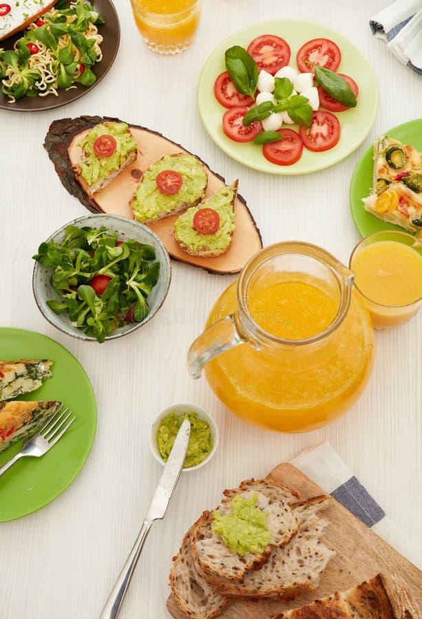 Orange juice on dinner table stock photos