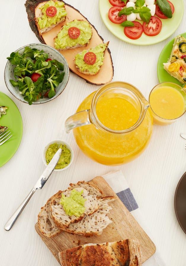Orange juice on dinner table stock image