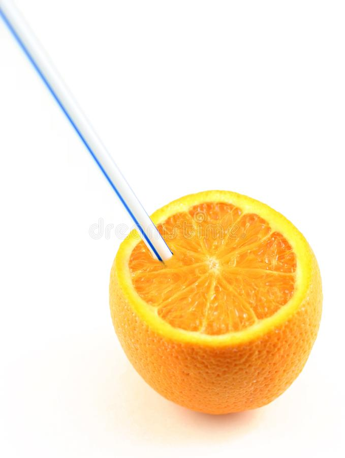Orange juice drunk directly from the fruit royalty free stock photography