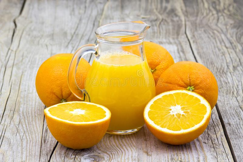 Orange juice and fresh fruits. Orange juice and fresh ts on wooden background stock photography