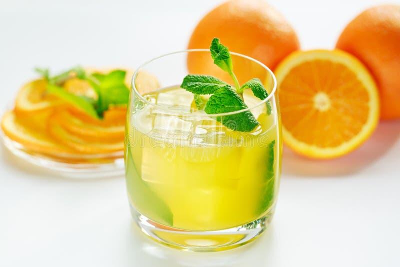 Orange juice and fresh mint royalty free stock photography
