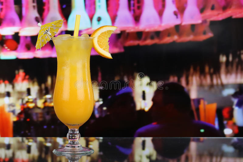 Orange juice fruit cocktail in a bar with copy space royalty free stock photography