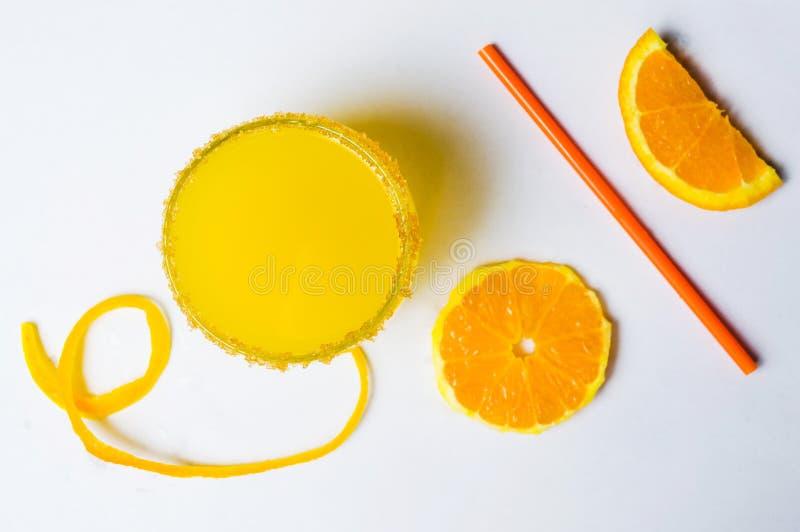Orange juice with fruit slices on white royalty free stock photo