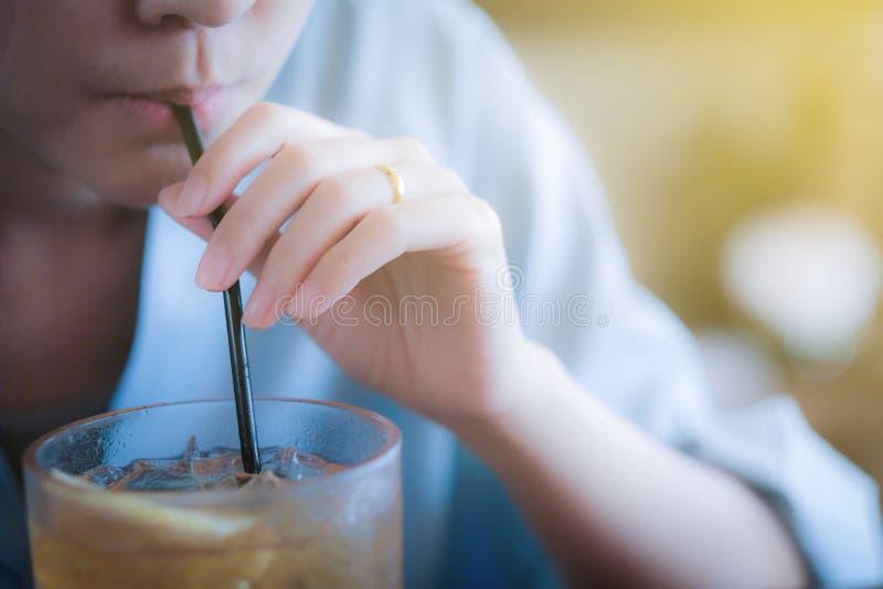 Orange juice. The girl is drinking orange juice in a Thai restaurant in Bangkok stock images