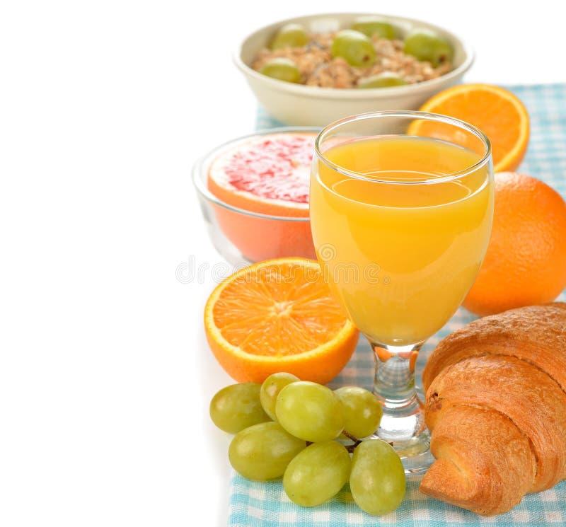 Orange juice, grapes and croissant stock image