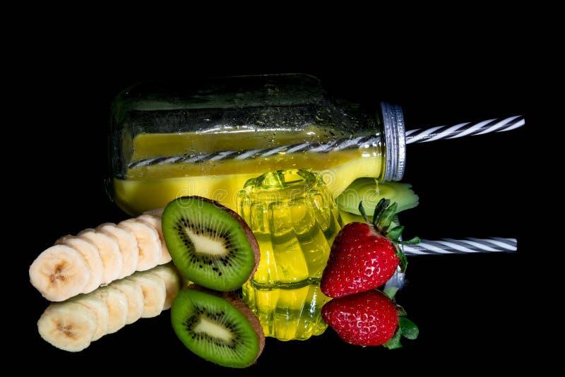 Orange juice , lemon jelly and fresh fruit isolated royalty free stock image