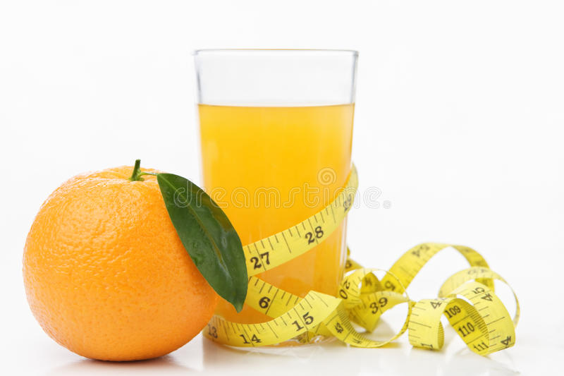 Orange and juice with measuring tape stock images