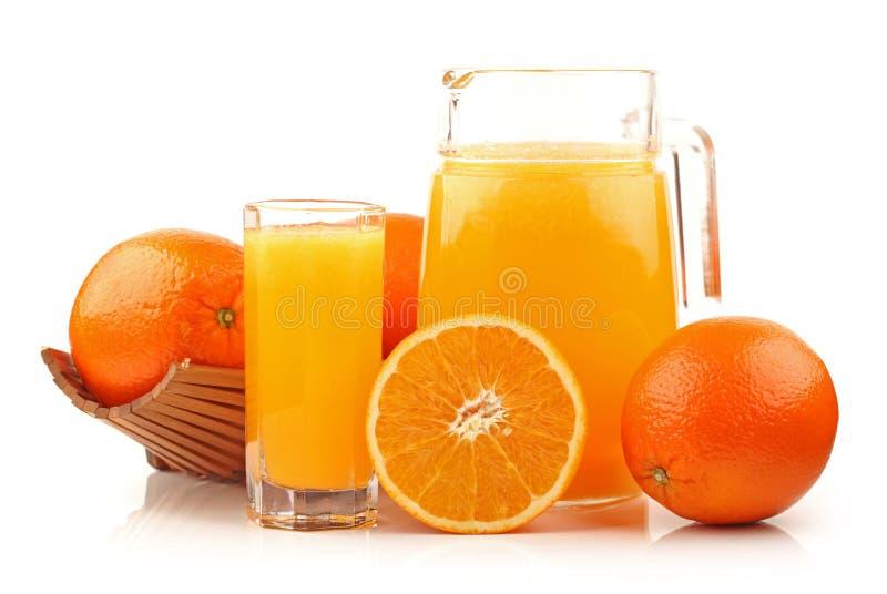 Orange juice with orange and green leaf royalty free stock image