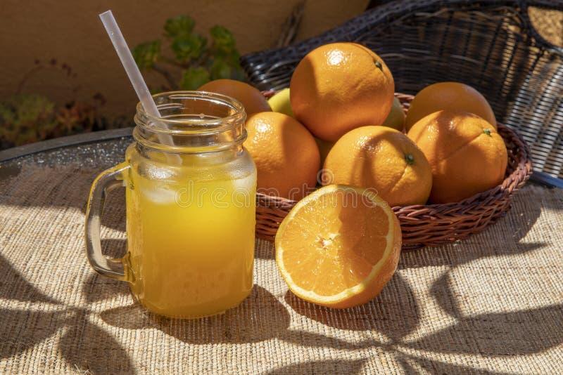 Orange juice in a glass jar royalty free stock image