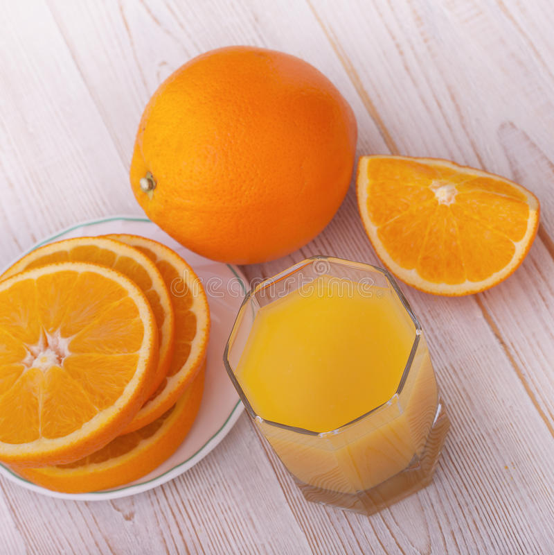 Orange juice with sliced orange half on wooden royalty free stock photography