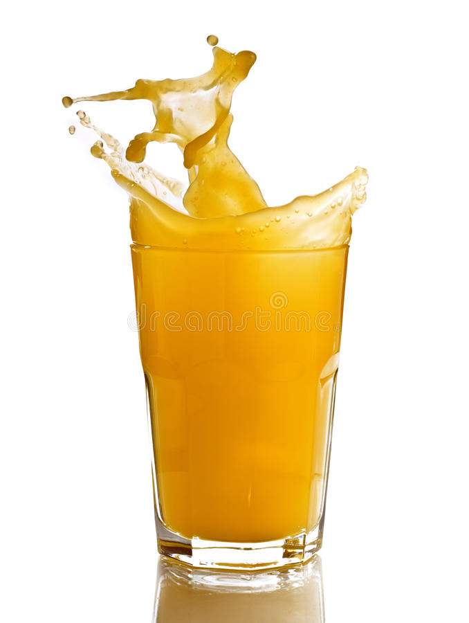 Orange juice splash in a glass stock images