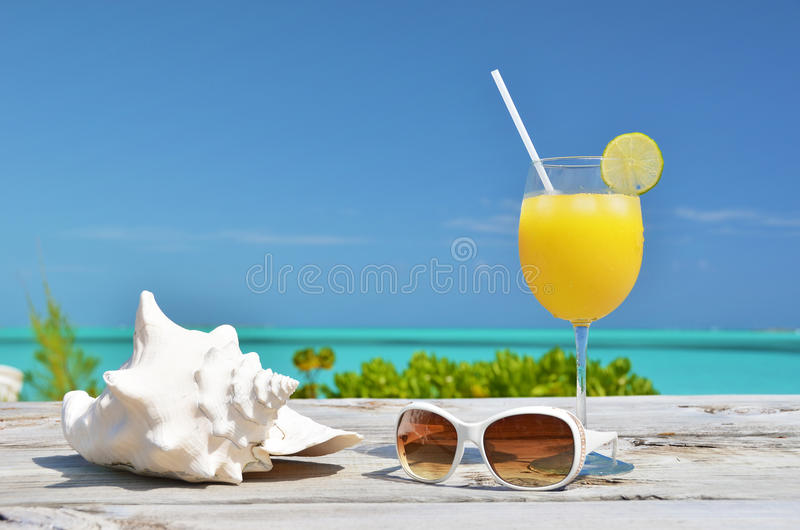 Orange juice and sunglasses stock photo