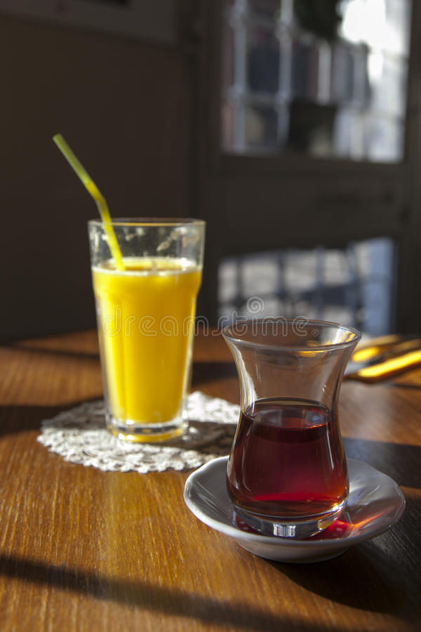 Orange Juice and Tea royalty free stock photo