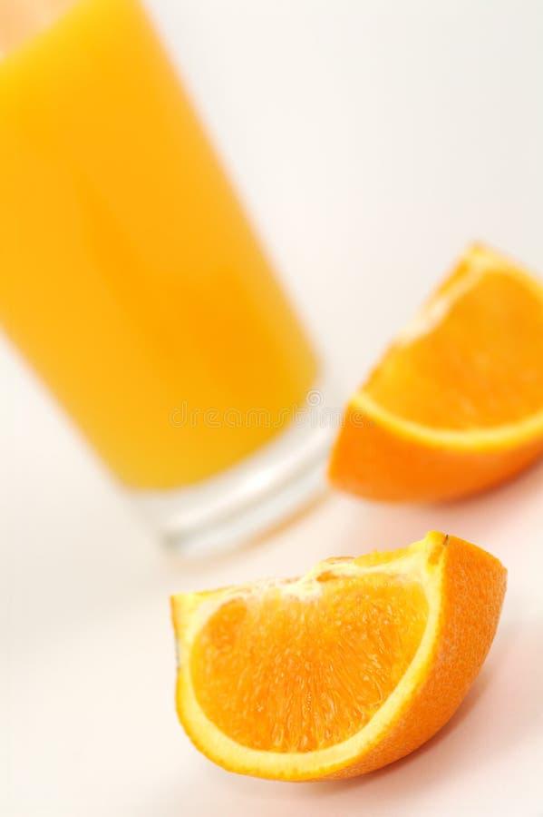 Orange juice and wedges stock photos