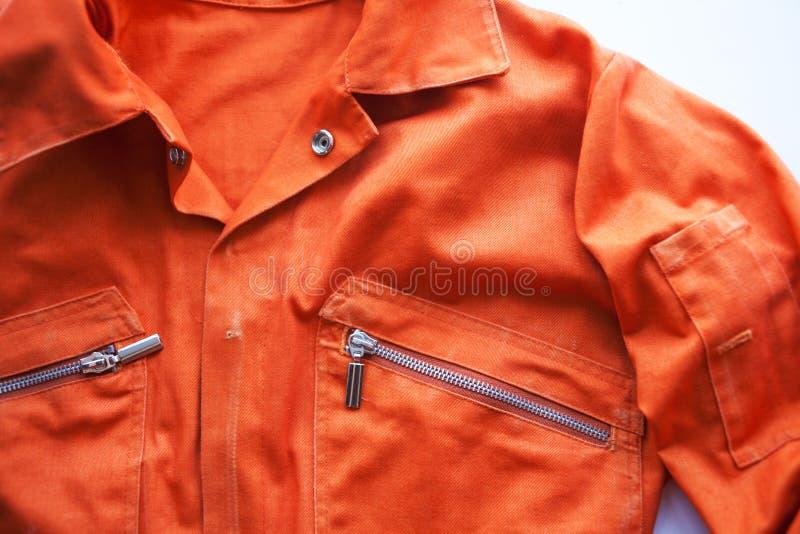 An orange jumpsuit of a prisoner. Prison clothes, jumpsuit sentenced to correctional labor,community payback. An orange jumpsuit of a prisoner. close up. Prison stock images