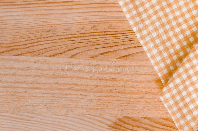 Orange karierte Gewebetischdecke lizenzfreie stockfotos