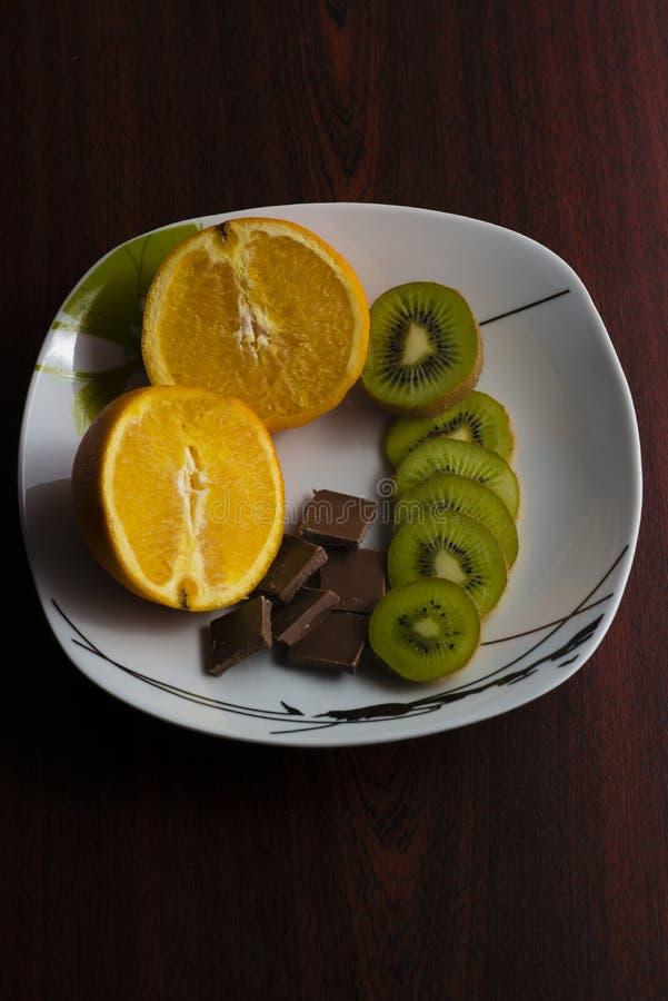 Orange, kiwi , chocolate royalty free stock image