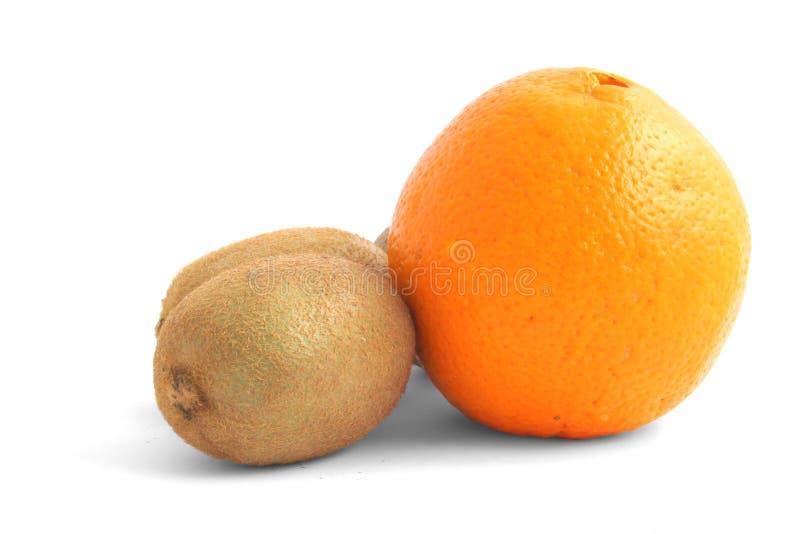 Orange and kiwi fruits on white royalty free stock image