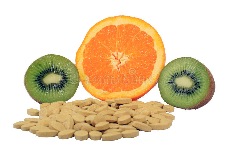 Orange and kiwi with vitamin pills