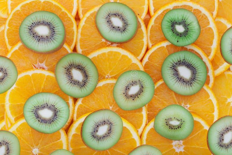Orange and kiwit rings as background stock photos