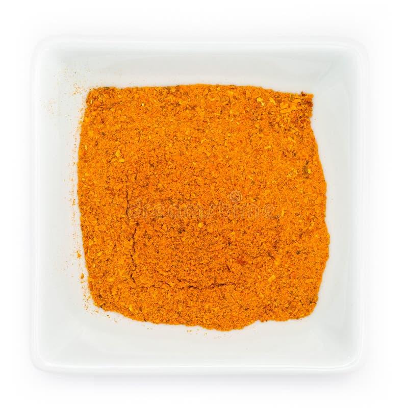 Orange kryddig madras curry i en vit bunke royaltyfri fotografi