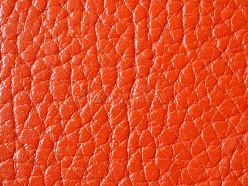 Orange lädertexturcloseup, bakgrund royaltyfri foto