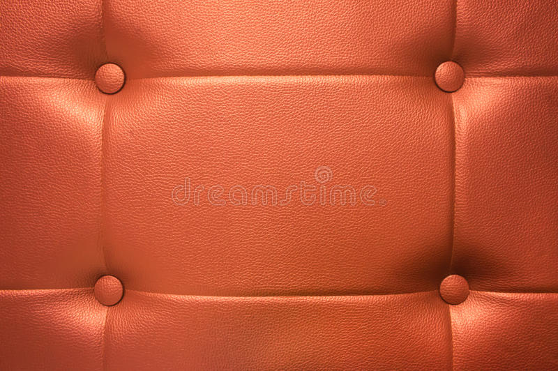Orange leather background texture. With buttons decorated royalty free stock images