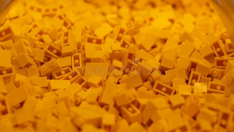 Orange Lego blocks, plastic construction toy, manufactured by The Lego Group based in Denmark. London, UK - January 2019: Orange Lego blocks, plastic stock photo