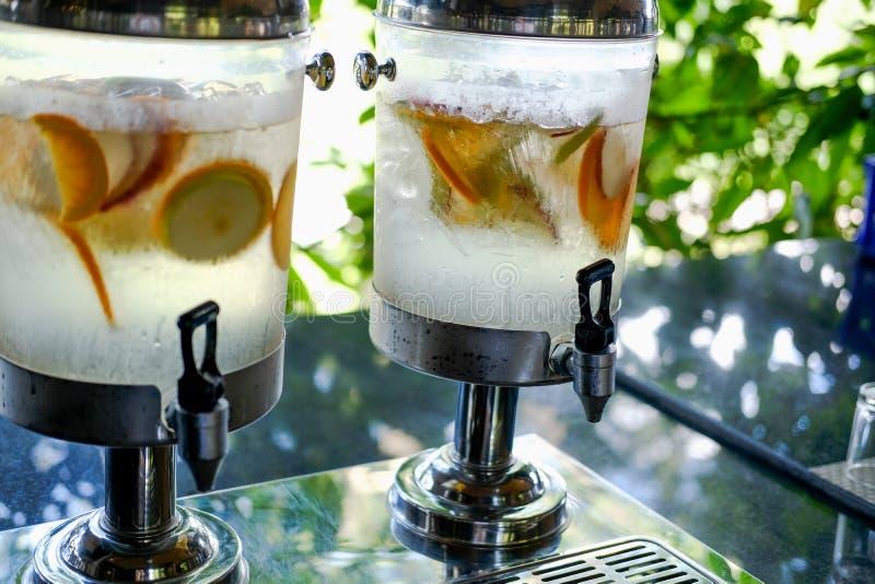 Orange lemon apple fruit slices floating in water. refreshing drink stock photos