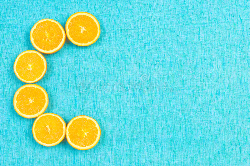 Orange and lemon citrus fruit pattern on light blue background stock photography