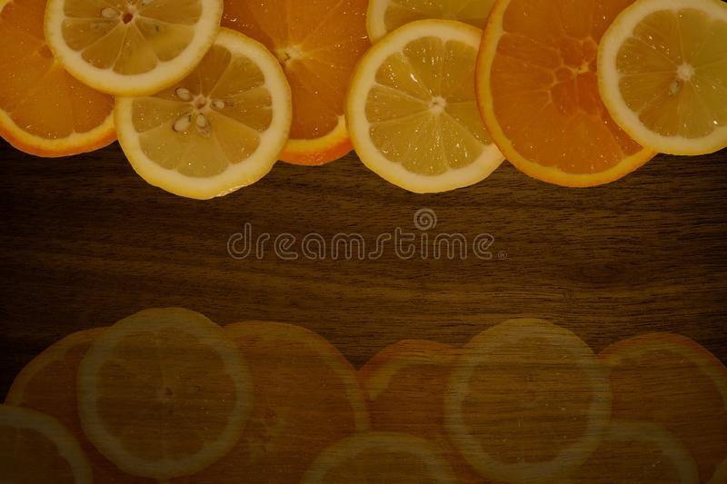 Orange and lemon sliced on a wooden table. royalty free stock photo