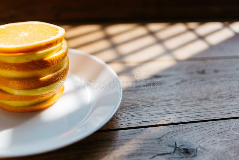 Orange and lemon slices pile stock images