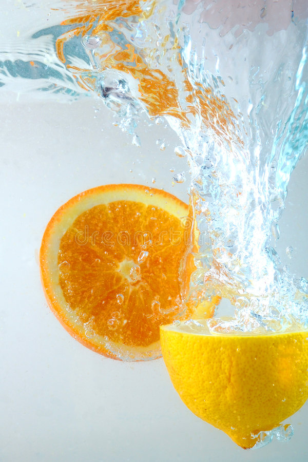 Orange and lemon in water royalty free stock image