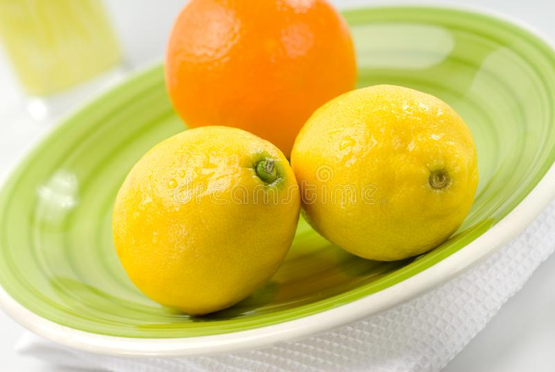 Download Orange And Lemons On Green Plate Stock Photo - Image: 8179934