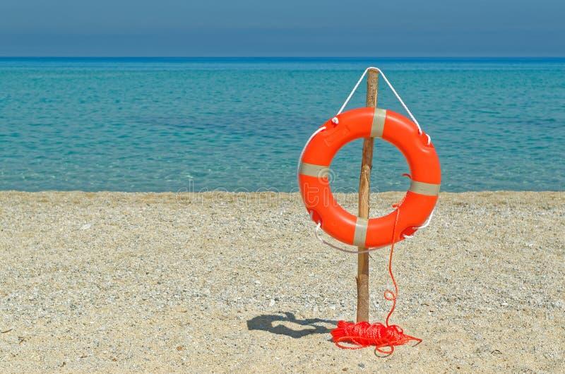 Orange Life Buoy on the sandy beach. Riaci, near Tropea, Italy stock image