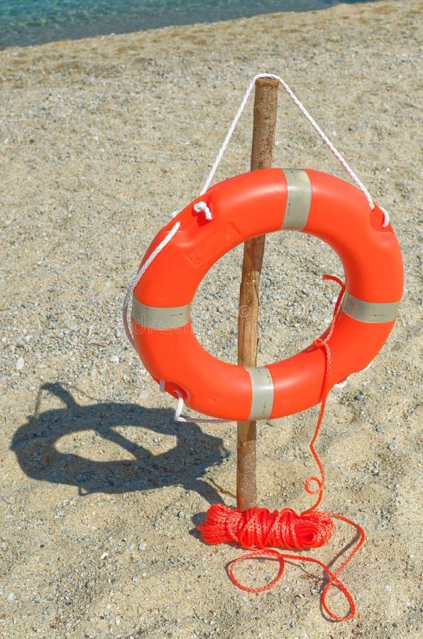 Orange Life Buoy on the sandy beach. Riaci. Riaci beach is located near Tropea, Italy royalty free stock images