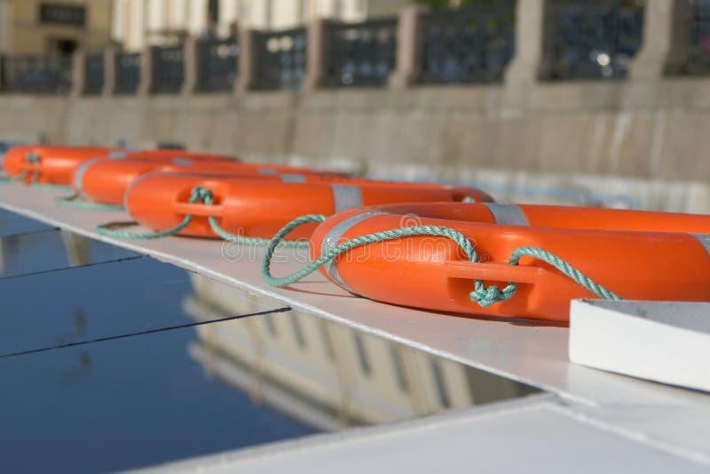 Orange life buoys on board royalty free stock photography
