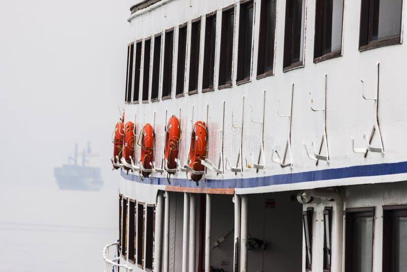 Orange life buoys of a boat royalty free stock photos