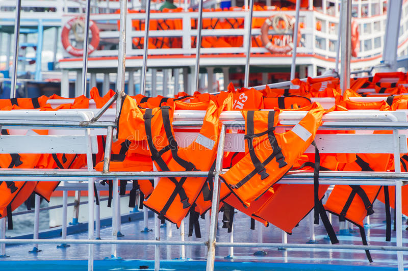 Orange Life Jacket. In The boat royalty free stock photos