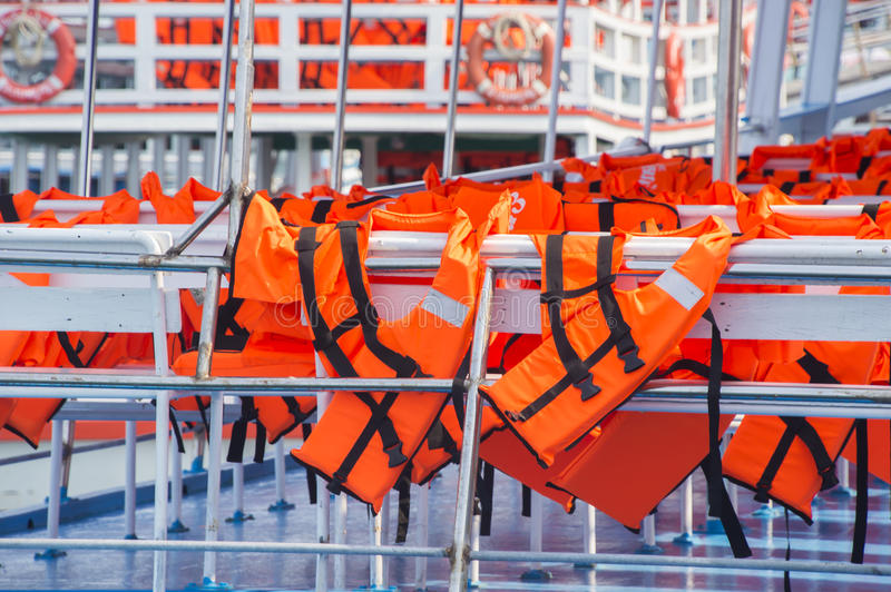 Orange Life Jacket. In The boat royalty free stock photography